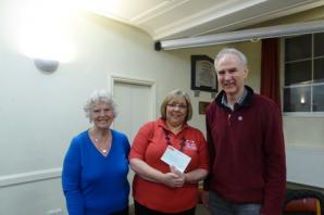 Haworth actors present their treasure to British Heart Foundation