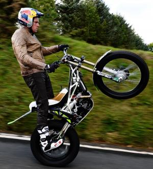 Keighley News: MOTORBIKING grandmaster Dougie Lampkin has successfully wheelied around the Isle of Man TT course, keeping up on his back wheel for 37.7 miles. 